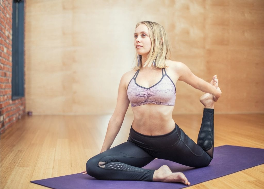 yoga woman 10 benefits of hot yoga that you must know