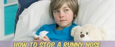 kid with runny nose in bed
