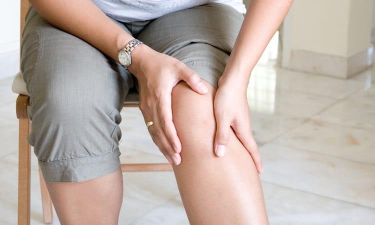 woman holding her leg arthritis