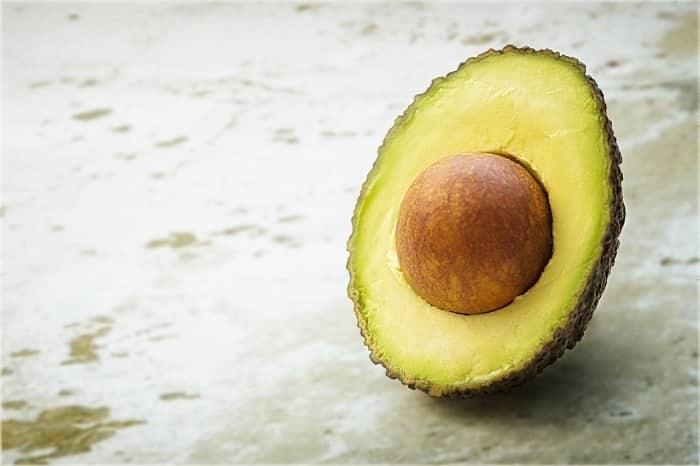 half an avocado on a table