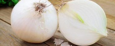 white onions on cutting board