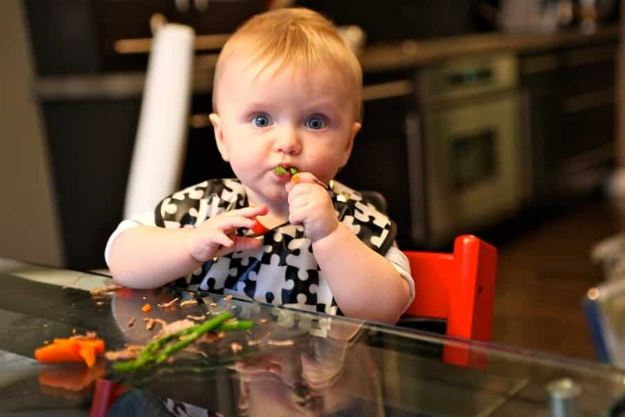 Baby eating asparagus