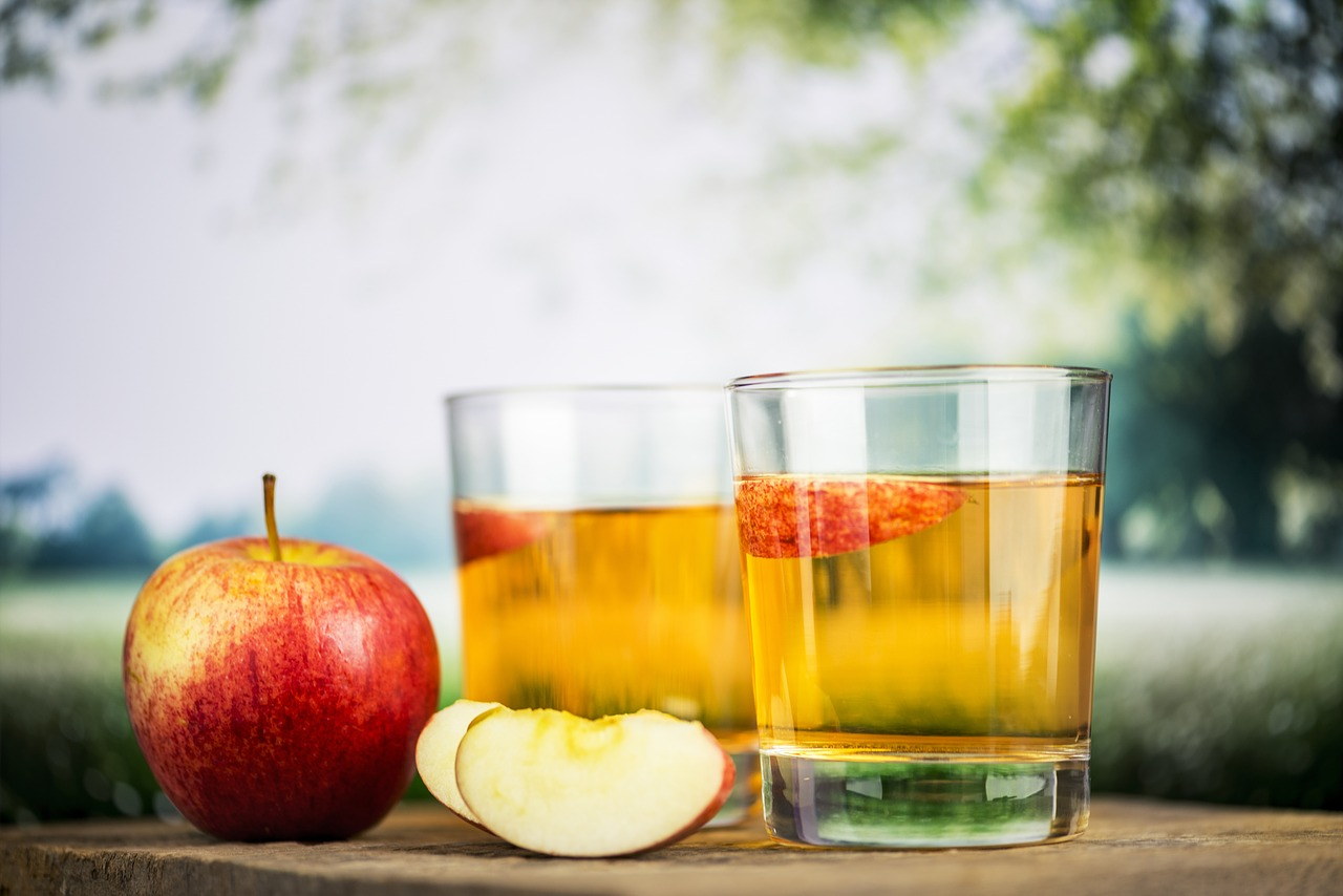 two glasses of apple cider which you can use as gargle as home remedy against tonsil stones