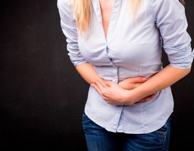 a woman experiencing pain in lower abdomen and needs natural remedies for uti