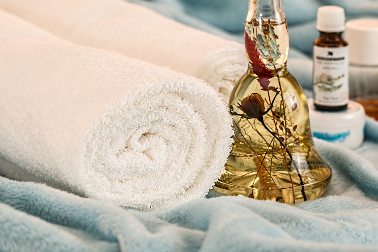 towels and essential oil infused with flower and herbs