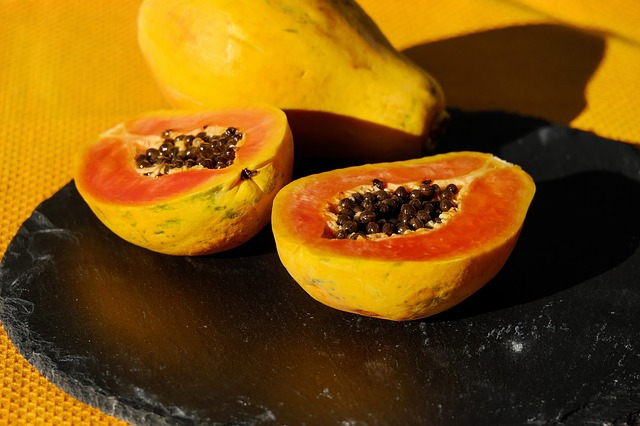 two halves of papaya which helps induce period