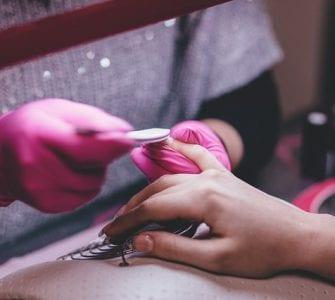 a woman having her fingernails trimmed properly to avoid ingrown fingernail