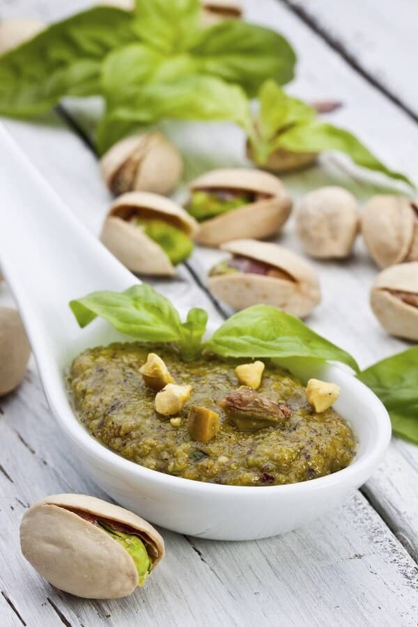 health benefits of pistachio paste and oil in a ceramic spoon
