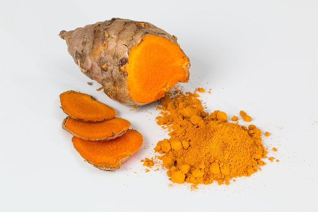 powdered and a half slice of raw turmeric, used to induce monthly period